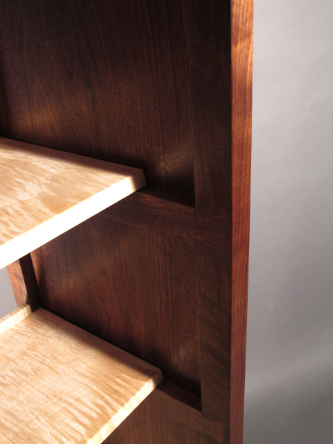 open shelving with dovetail accent