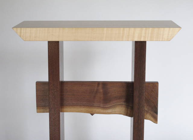 A live edge table stretcher adds a touch of nature to your interior designs- pictured here on our Statement Accent Table in tiger maple and walnut